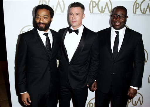 Steve McQueen, right, Chiwetel Ejiofor, left, and Brad Pitt arrive at the 25th annual Producers Guild of America Awards at the Beverly Hilton Hotel in Beverly Hills, Calif. on Sunday, Jan. 19, 2014. (Photo by Matt Sayles/Invision/AP)