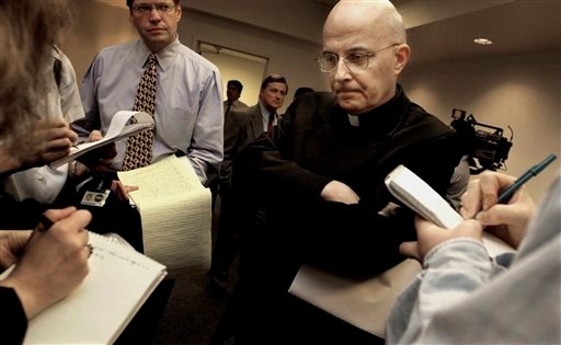 April 17, 2002 file photo: Chicago Cardinal Francis George listening to reporters' questions before he left for Rome to meet with Vatican officials and other American cardinals about the child sex abuse scandals in the US.(AP Photo/M. Spencer Green, File)