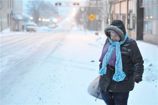Susan Miller of Windber, Pa. walks during the snow storm on Tuesday, Jan. 21, 2014. The National Weather Service said the storm could bring 8 to 12 inches of snow to Philadelphia and New York City, and more than a foot in Boston. (AP Photo)