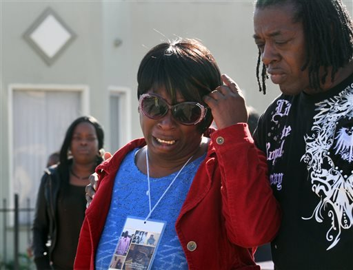 In this photo from Jan. 20, 2014, Dinyal New, center, mother of Lamar Broussard, who was killed Sunday with his best friend Derryck Harris, both 19, mourns the loss of the second son to have been killed this year. (AP)