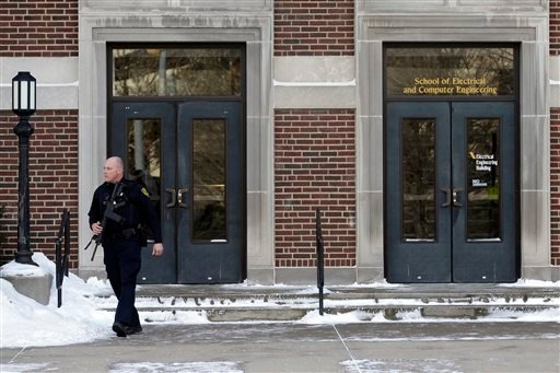 A police officer walks out of the Electrical Engineering Building on the campus of Purdue University in West Lafayette, Ind., Tuesday, Jan. 21, 2014. (AP)