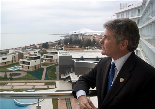 U.S. Congressman, Rep. Michael McCaul, Chairman of the House Homeland Security Committee, stands on a balcony of his hotel which overlooks the Olympic Park, in the Black Sea resort of Sochi Jan. 21, 2014. (AP Photo/Nataliya Vasilyeva)
