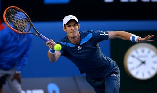 Andy Murray of Britain makes a forehand return to Roger Federer of Switzerland during their quarterfinal at the Australian Open tennis championship in Melbourne, Australia, Wednesday, Jan. 22, 2014.(AP Photo/Aaron Favila)