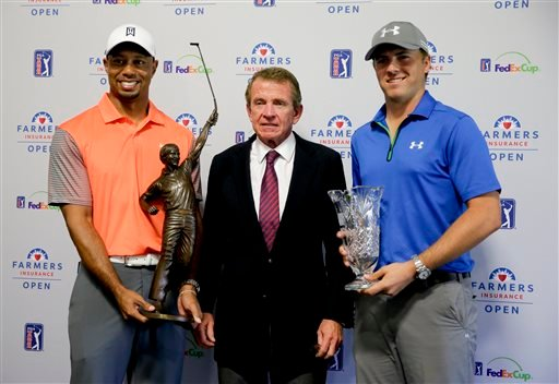 Tiger Woods, left, 2013 PGA Tour Player of the Year, and Jordan Spieth, right, PGA Tour Rookie of the Year, pose with PGA Tour Commissioner Tim Finchem and their trophies during a presentation at the Farmers Insurance Open golf tournament.