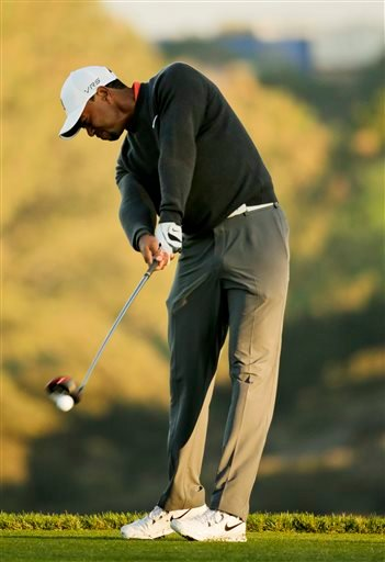 Tiger Woods hits his tee shot on the fifth hole during the pro-am at the Farmers Insurance Open golf tournament at Torrey Pines Golf Course on Wednesday, Jan. 22, 2014, in San Diego.