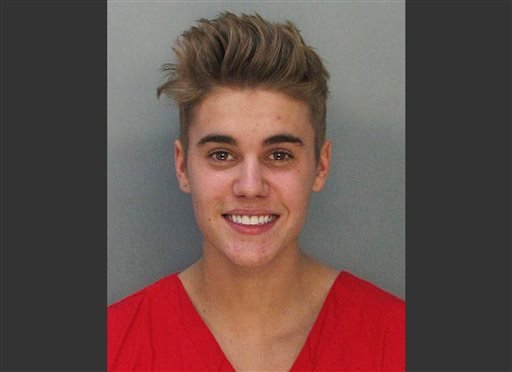 This police booking mug made available by the Miami Dade County Corrections Department shows pop star Justin Bieber, Thursday, Jan. 23, 2014. (AP)