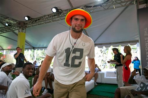 Indianapolis Colts quarterback Andrew Luck walks out to the stage after being chose in the NFL football Pro Bowl draft, Wednesday, Jan. 22, 2014, in Kapolei, Hawaii.