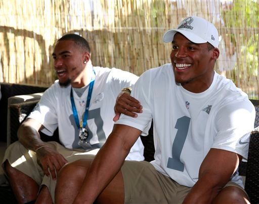 Philadelphia Eagles wide receiver DeSean Jackson (10) jokes around with Carolina Panthers quarterback Cam Newton (1) in the green room at the NFL Pro Bowl football draft, Wednesday, Jan. 22, 2014, in Kapolei, Hawaii.