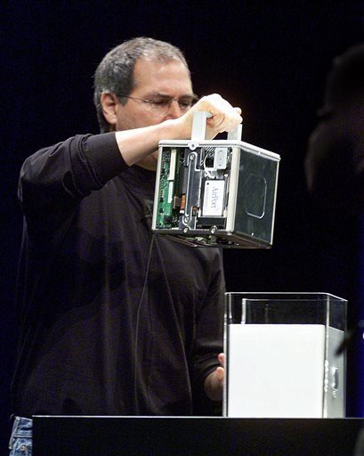 FILE - In this Wednesday, July 19, 2000, file photo, Steve Jobs, CEO of Apple Computer Inc, shows off the inside of his company's new Power Macintosh G4, an 8-inch cube computer, during his keynote address at MacWorld Expo in New York in 2000. (AP)