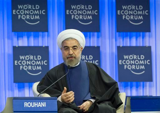 Iranian President Hassan Rouhani gestures as speaks during a session of the World Economic Forum in Davos, Switzerland, Thursday, Jan. 23, 2014. (AP)