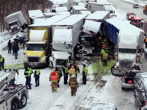 In this photo provided by the Indiana State Police, emergency crews work at the scene of a massive pileup involving more than 40 vehicles, many of them semitrailers, along Interstate 94 Thursday afternoon, Jan. 23, 2014 near Michigan City, Ind.