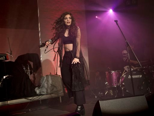 In this Oct. 31, 2013 file photo, New Zealand singer-songwriter Lorde performs on stage during the Vevo Halloween Concert at the Oval Space in east London.