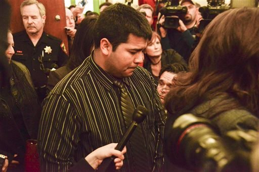 Erick Munoz, husband of Marlise Munoz, is escorted out of court by his attorney Heather L. King, right, Friday, Jan. 24, 2014 in Fort Worth, Texas. (AP)