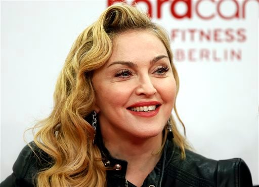 "FILE - In this Thursday, Oct. 17, 2013 file photo, U.S. pop star Madonna smiles during her visit at the ""Hard Candy Fitness"" center in Berlin. (AP)"