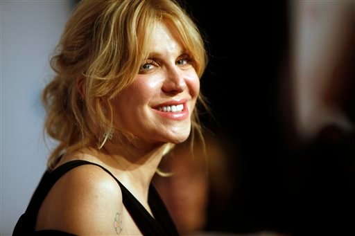 "In this Oct. 15, 2013 file photo, Courtney Love arrives at the Elton John AIDS Foundation's 12th Annual ""An Enduring Vision"" benefit gala at Cipriani Wall Street, in New York."
