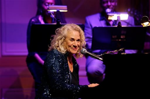 In this May 21, 2013 file photo, singer-songwriter Carole King, performs during an event to honor her with the Gershwin Prize for Popular Song, at the Library of Congress, in Washington.