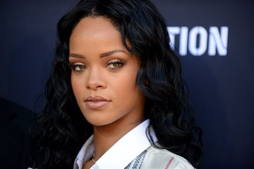 Rihanna arrives at the Roc Nation 2014 Pre-Grammy Brunch Celebration on Saturday, Jan. 25, 2014, in Los Angeles. (Photo by Jordan Strauss/Invision/AP)
