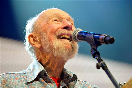 This Sept. 21, 2013, file photo shows Pete Seeger performing on stage during the Farm Aid 2013 concert at Saratoga Performing Arts Center in Saratoga Springs, N.Y.