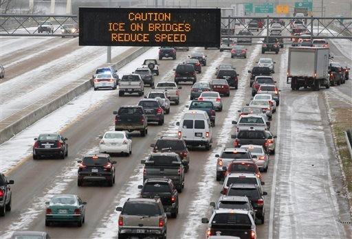 Traffic creeps along Interstate 55 in north Jackson, Miss., Tuesday, Jan. 28, 2014, as ice and snow flurries cause difficult driving conditions. A severe winter storm is expected to hit the state, bringing ice and snow to the Gulf Coast. (AP Photo)