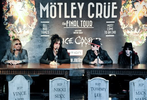 From left, Vince Neil, Nikki Sixx, Tommy Lee, and Mick Mars attend the Motley Crue Press Conference, Tuesday, Jan. 28, 2014, in Los Angeles. (AP)