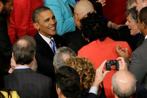 President Barack Obama is greeted as he arrives to give his State of the Union address on Capitol Hill in Washington, Tuesday Jan. 28, 2014. (AP Photo/J. Scott Applewhite)