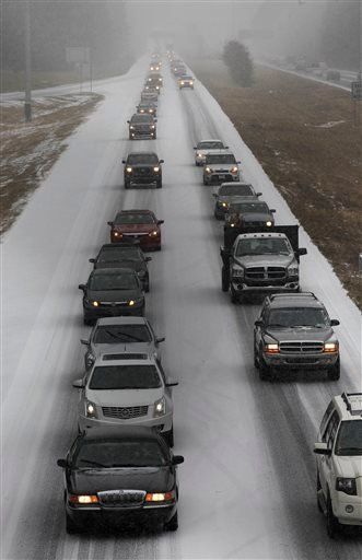 Vehicles moves slowly on Interstate 575 in North West Ga., Tuesday, Jan. 28, 2014, near Kennesaw, Ga. (AP Photo/Mike Stewart)
