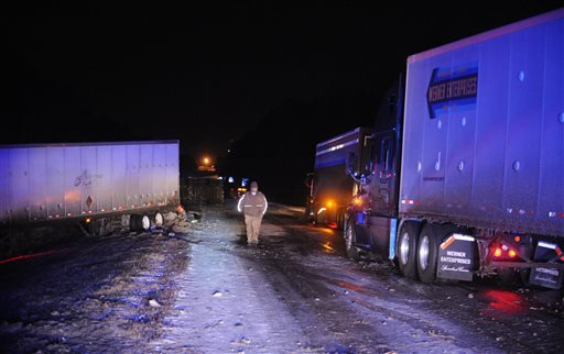 The scene of a multi-vehicle accident on Interstate 59 south of Hardy Street Tuesday night Jan. 28, 2014 in Hattiesburg, Mississippi. (AP Photo/Hattiesburg American, Ryan Moore)