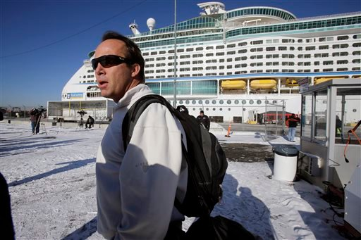 Rick O'Shea answers a question as he waits to board the Explorer of the Seas cruise ship after it docked at a berth in Bayonne, N.J., Wednesday, Jan. 29, 2014. (AP)