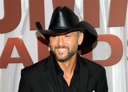 FILE - In this Nov. 9, 2011 file photo, country singer Tim McGraw arrives at the 45th Annual CMA Awards in Nashville, Tenn. (AP)