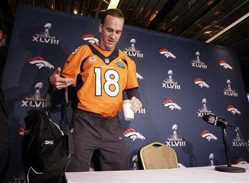 Denver Broncos quarterback Peyton Manning arrives for a news conference Wednesday, Jan. 29, 2014, in Jersey City, N.J. (AP)