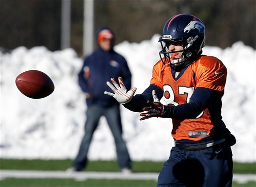 Denver Broncos wide receiver Wes Welker (83) catches a pass during practice Wednesday, Jan. 29, 2014, in Florham Park, N.J.