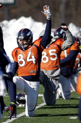 Denver Broncos tight end Jacob Tamme (84) stretches during practice Wednesday, Jan. 29, 2014, in Florham Park, N.J.