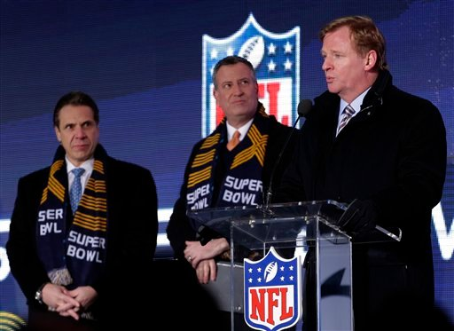 NFL comissioner Roger Goodell, right, speaks while New York City Mayor Bill de Blasio, center, and New York Gov. Andrew Cuomo, left, look on during a ceremony unveiling the Roman numerals for Super Bowl XLVIII on Super Bowl Boulevard Wednesday, Jan. 29.