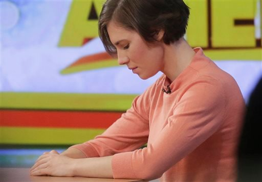 Amanda Knox bows her head during a television interview, Friday, Jan. 31, 2014 in New York.
