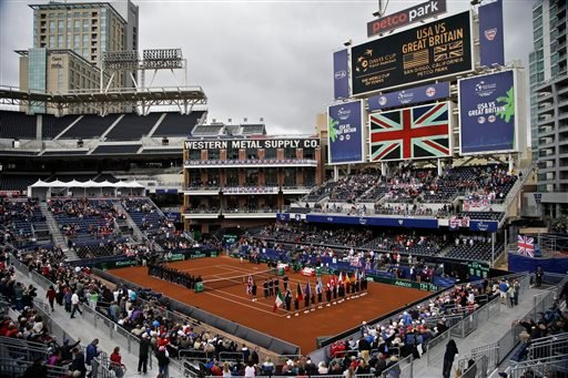 Players line the court during the pening ceremony for a Davis Cup tennis match between the United States and Great Britain, that takes place in the left field corner at Petco Park, home fo the San Diego Padres baseball team.
