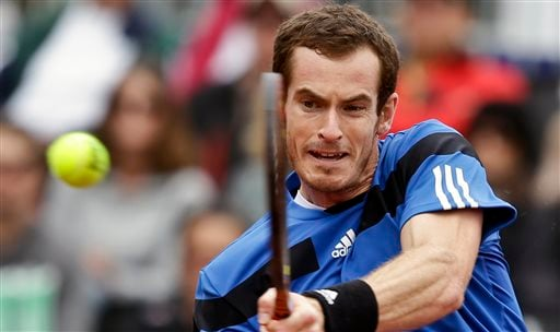 Britain's Andy Murray slams a backhand shot in his 6-1, 6-2, 6-3 victory over Donald Young in a Davis Cup tennis match on Friday, Jan. 31, 2014, in San Diego. (AP Photo/Lenny Ignelzi)