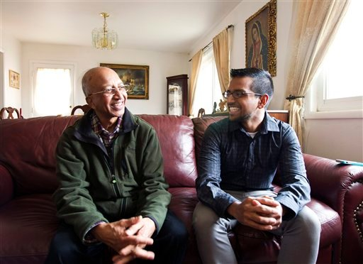 Yves Gomes, a student at the University of Maryland, who's parents were deported, right, talks to his great uncle Henry Gomes, in his great uncle's house where he lives, in Silver Spring, Md., Friday Jan. 17, 2014.