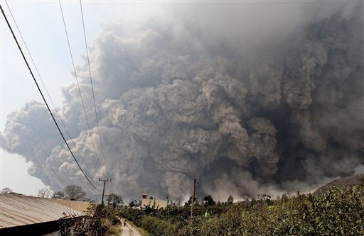 Mount Sinabung releases pyroclastic flows during an eruption as seen from Namantaran, North Sumatra, Indonesia, Saturday, Feb. 1, 2014.