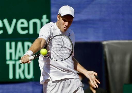 Britain's Dominic Inglot returns a shot from the United States team during a doubles match at the Davis Cup tennis matches, Saturday, Feb. 1, 2014, in San Diego. (AP Photo/Lenny Ignelzi)