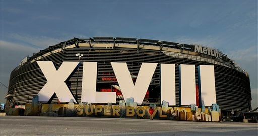 A sign for NFL football's Super Bowl XLVIII stands in front of MetLife Stadium Sat. Feb. 1, 2014, in East Ruthoford, N.J. The stadium will be the site of Sunday's championship game between the Denver Broncos and the Seattle Seahawks.