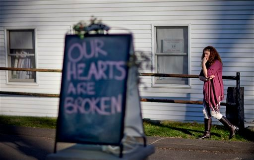 In this Dec. 15, 2012 file photo, shop owner Tamara Doherty paces outside her store just down the road from Sandy Hook Elementary School in Newtown, Conn.