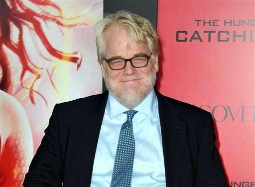"This Nov. 18, 2013 file photo shows Philip Seymour Hoffman at the Los Angeles premiere of ""The Hunger Games: Catching Fire"" at Nokia Theatre LA Live."