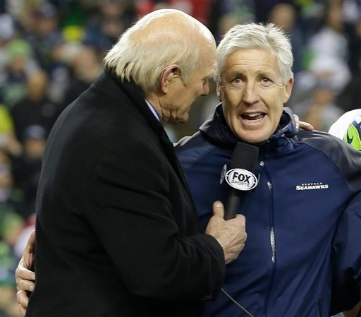 Former NFL player and sports broadcast host Terry Bradshaw interviews Seattle Seahawks head coach Pete Carroll after the NFL football NFC Championship game against the San Francisco 49ers Sunday, Jan. 19, 2014, in Seattle.