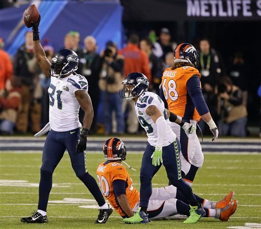 Seattle Seahawks' Kam Chancellor (31) celebrates after intercepting a pass intended for Denver Broncos tight end Julius Thomas (80) during the first half of the NFL Super Bowl XLVIII football game Sunday, Feb. 2, 2014, in N.J. (AP Photo/Gregory Bull)