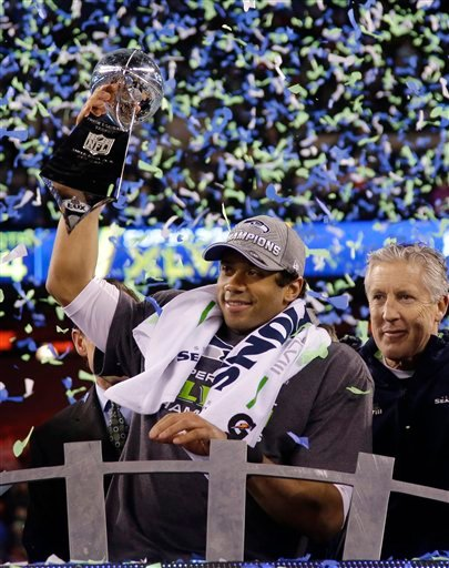 Seattle Seahawks' Russell Wilson holds the Vince Lombardi Trophy after the NFL Super Bowl XLVIII football game against the Denver Broncos Sunday, Feb. 2, 2014, in East Rutherford, N.J. The Seahawks won 43-8. (AP Photo/Matt Slocum)