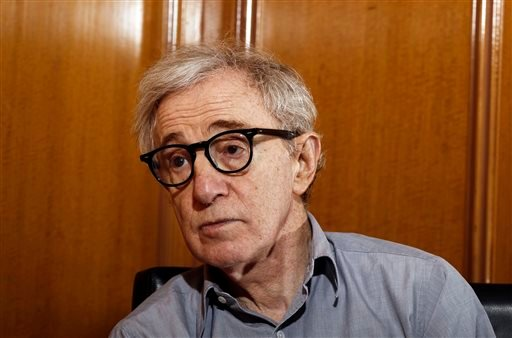 """FILE - In this Dec. 29, 2011 file photo, Woody Allen, director of the film, """"Midnight in Paris,"""" is photographed during an interview in Beverly Hills, Calif. (AP)"""