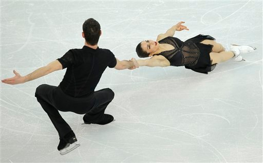 Marissa Castelli and Simon Shnapir of the United States compete in the team pairs short program figure skating competition at the Iceberg Skating Palace during the 2014 Winter Olympics, Thursday, Feb. 6, 2014, in Sochi, Russia.