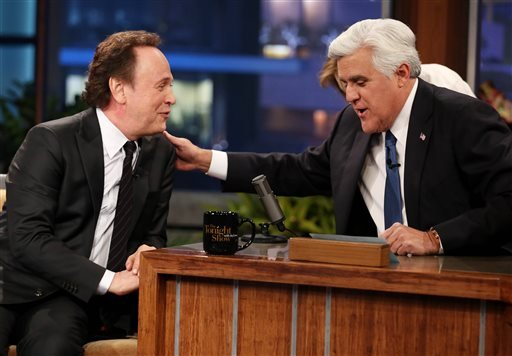 "Jay Leno, right, and Billy Crystal appear during the final taping of NBC's ""The Tonight Show with Jay Leno,"" in Burbank, Calif., Thursday, Feb. 6, 2014. (Photo by Matt Sayles/Invision/AP)"