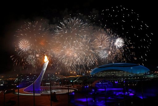 Fireworks are seen over the Olympic Park during the opening ceremony of the 2014 Winter Olympics in Sochi, Russia, Friday, Feb. 7, 2014.