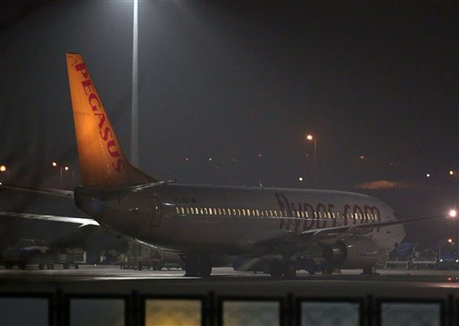 Turkish private company Pegasus passenger plane at the Sabiha Gokcen Airport in Istanbul, Turkey, Friday, Feb. 7, 2014. (AP Photo/Emrah Gurel)